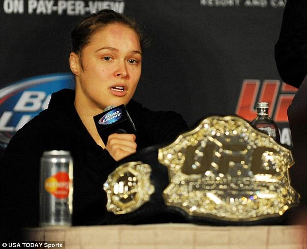 Winner, winner: The win Saturday secured Rousey the women's bantamweight belt