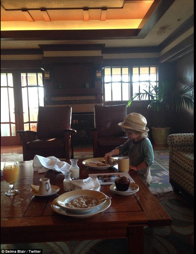 Happiest place on Earth: Selma tweeted this image on Friday, with the caption 'Casual breakfast in our handsome disneyland room'