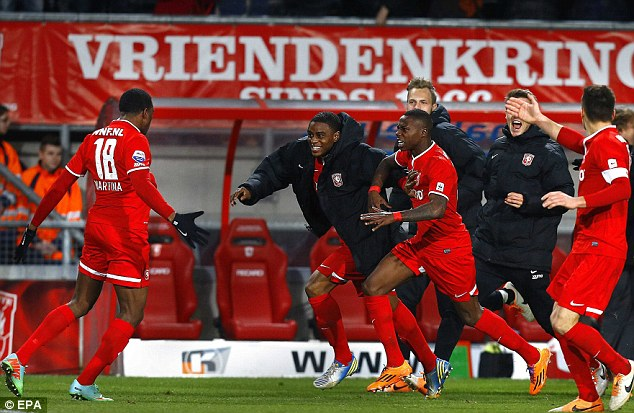 Last gasp: FC Twente player Cuco Martina (left) celebrates the equalizing goal with his team-mates