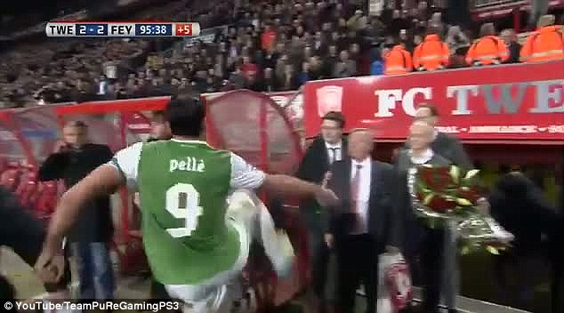 Lashing out: An angry Pelle kicks the side of the dug out on his way off the pitch