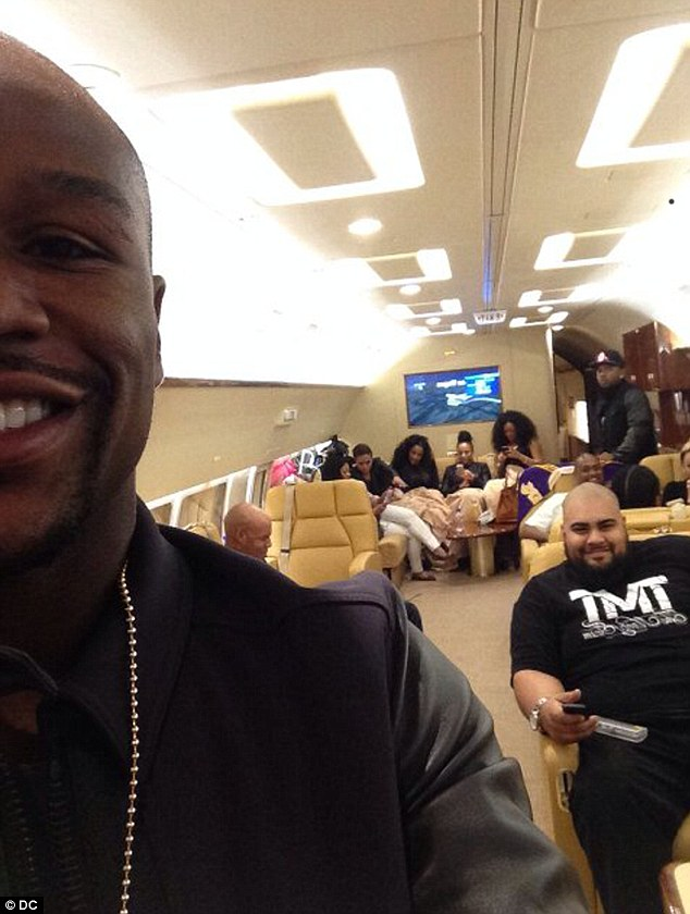 Self-promotion: Team Mayweather take to the sky as the fighter celebrates his 37th birthday in customary fashion