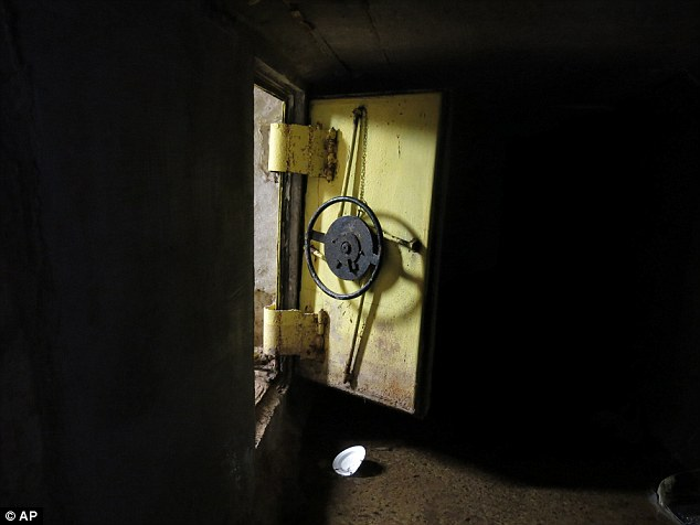 Elaborate tunnels: Guzman escaped firstly through an open steel reinforced door leading to a series of interconnected tunnels in the city's drainage system in the city of Culiacan. The above picture shows one of about seven of these doors