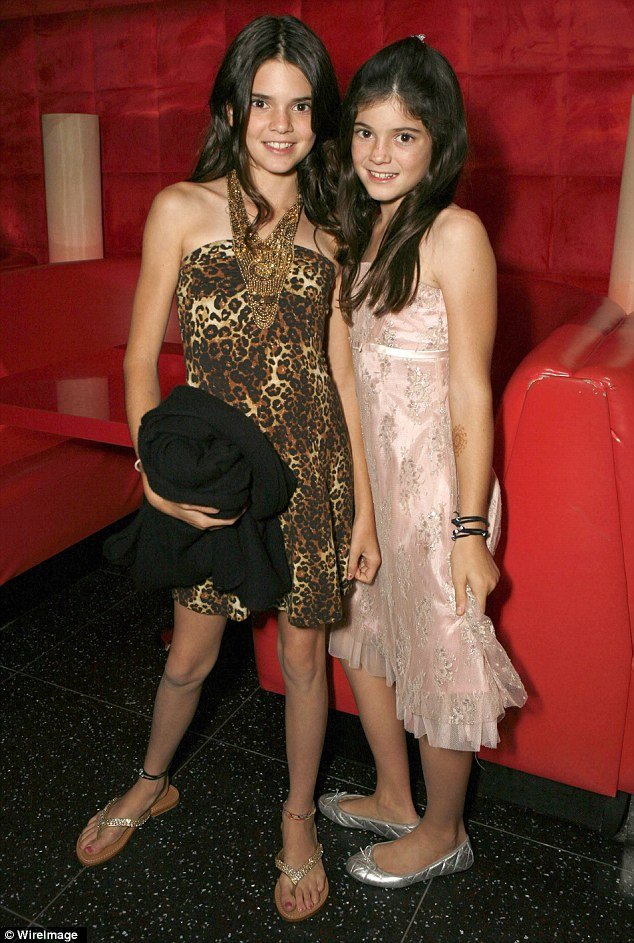 What cuties! Kylie admitted she followed her older sister 'everywhere she went', pictured in 2007 in California