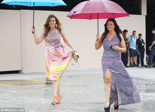 Wet 'n' wild: The mum of three and co-star Lydia keep it classy despite the wet weather in Sydney last Wednesday