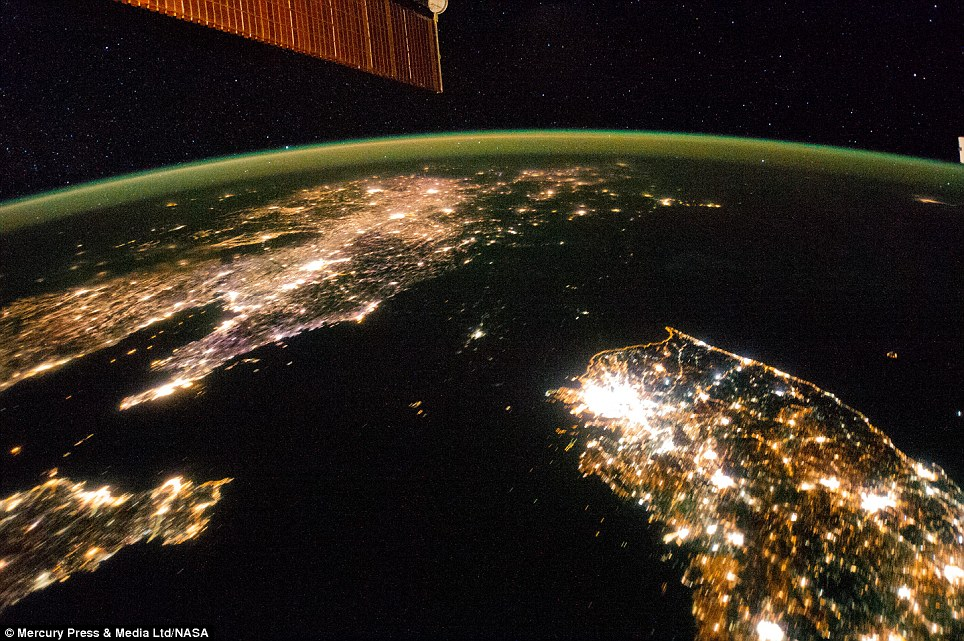 The image, taken from the International Space Station earlier this year, shows North Korea as a swathe of dark ground between China in the north and South Korea