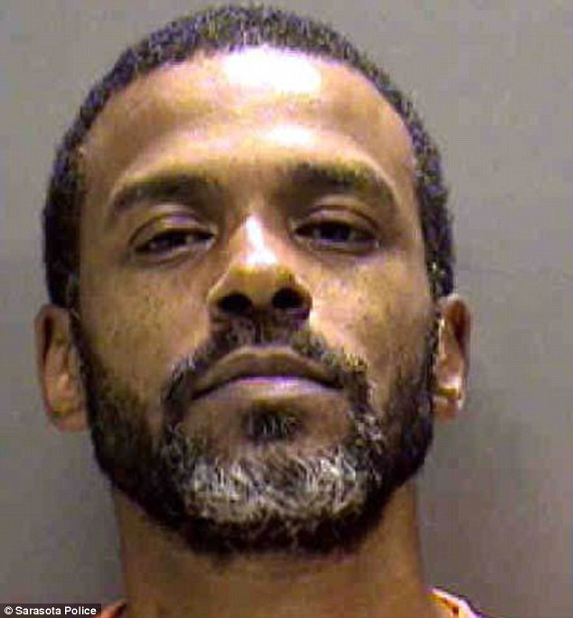 Charged: Ephrian Myles, 47, allegedly doued his girlfriend's three-month-old puppy Gizmo with hot sauce