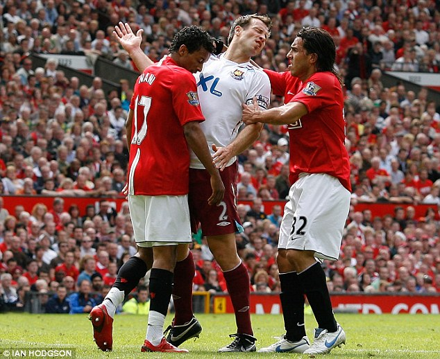 Not so tough: Neill reacts to an apparent headbutt from Manchester United winger Nani (left)