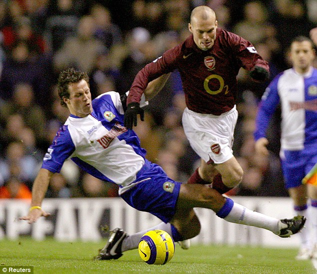 Reducer: Neill carved out a reputation as a tough-tackling defender, as Freddie Ljungberg discovered here