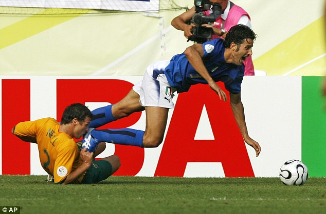 Strewth: Neill fouls Italy's Fabio Grosso to concede a penalty at the World Cup in 2006
