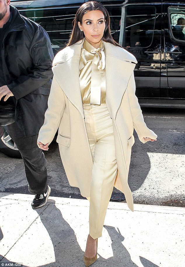 Frozen in time? Kim Kardashian's face was certainly feeling the benefit of the chilly New York weather on Monday as she stepped out with a taut-looking complexion