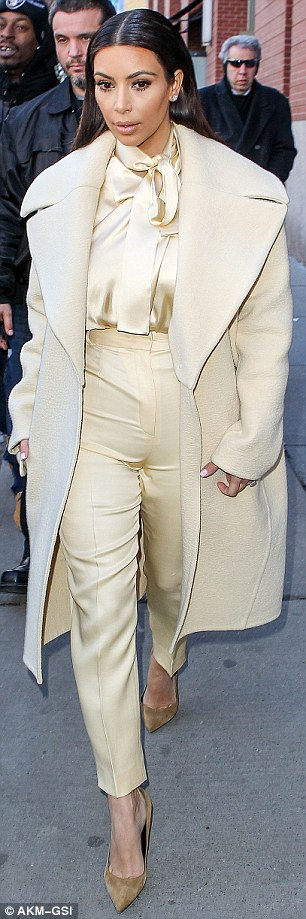 Stepping out: Kim looked particularly flawless as she was spotted in New York on Monday with Kanye West