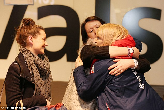 The unluckiest person in Sochi: Short track speed skater Elise Christie is welcomed by her family