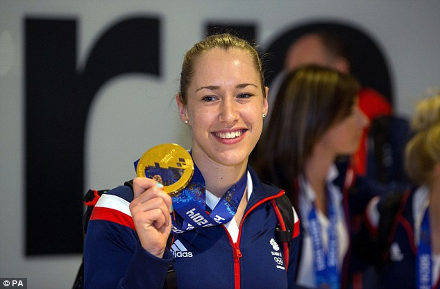 Queen of the ice: Yarnold shows off her gold medal that she won in the skeleton