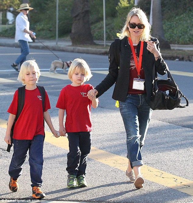 A trio of blondes! Naomi Watts holds hands with her blonde mini me's after doing the school run on Monday