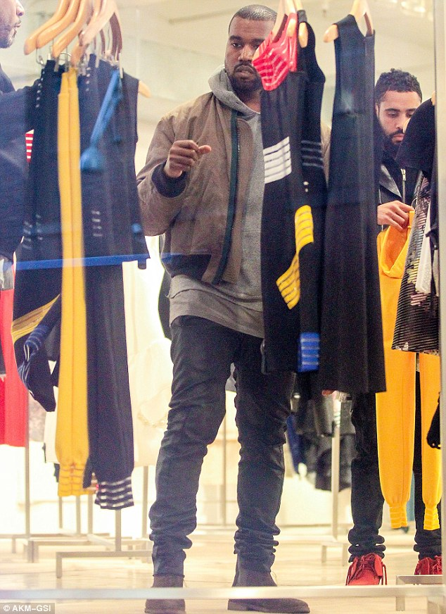 See anything you like? Kanye looked deep in concentration as he eyed up the offerings in the store