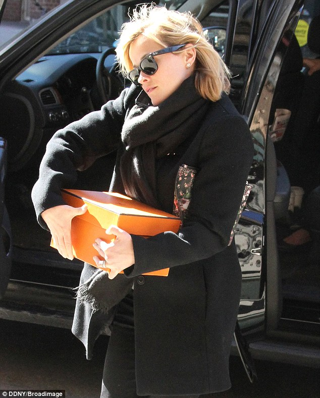 Mystery box: The star carried a brown box with her as she did some shopping before the show taping