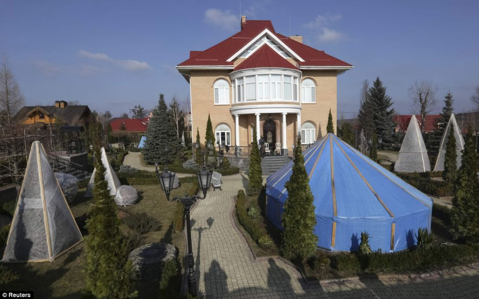 Secret garden: Behind the gardens are manicured lawns and gardens, with a path leading to the entrance of the house in Gorenichy, outside Kiev. It is now being explored by Ukrainians after Viktor Pshonka, the prosecutor-general, fled