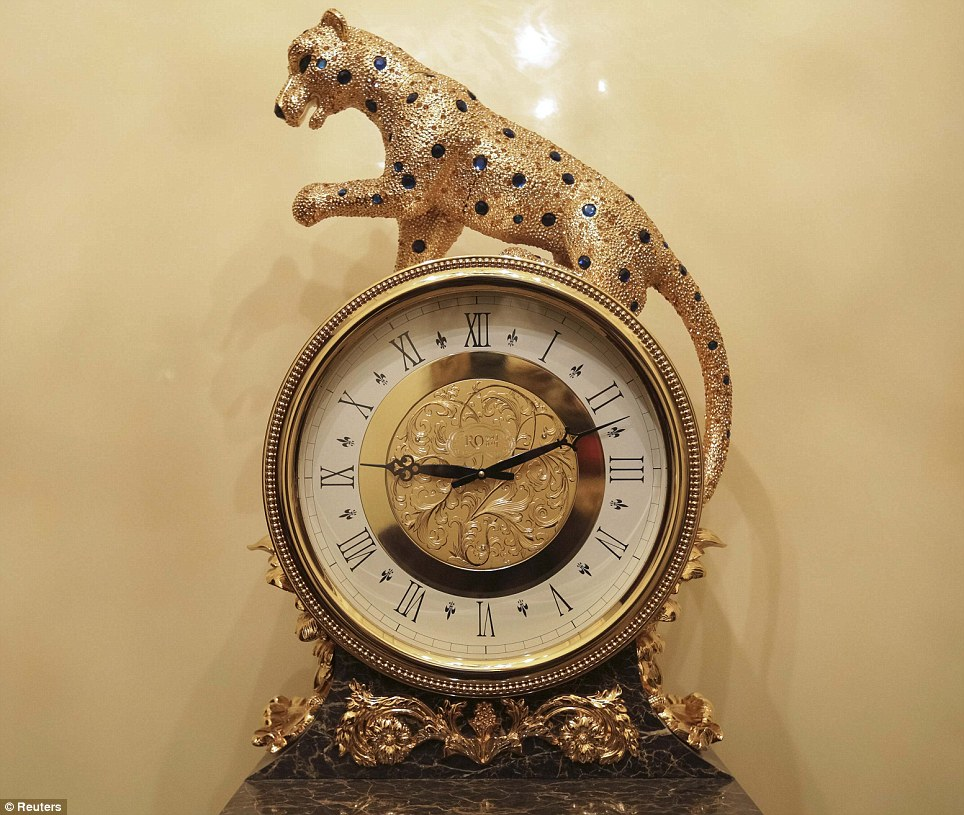 Exquisite: A jewel encrusted cat clock with big blue stones is one of the more opulent pieces photographed in Pshonka's home