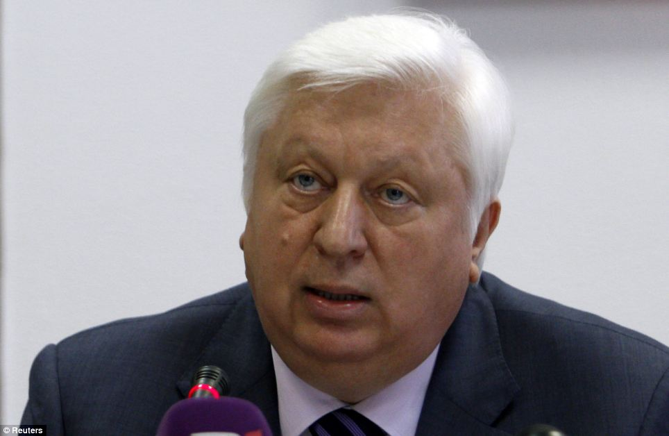 The house's owner, former prosecutor-general Viktor Pshonka. Before he fled, Pshonka was a key member of the government. He was responsible for the oversight of a series of agencies which opposition groups said were used to repress those who opposed president Vyktor Yanukovych, including the country's presidents. He is pictured here at a press conference in May 2012 in Kiev, where he denied that the jailed opposition leader Yulia Tyhmoshenko had been beaten by prison guards. She is now free and a contender to become the next president