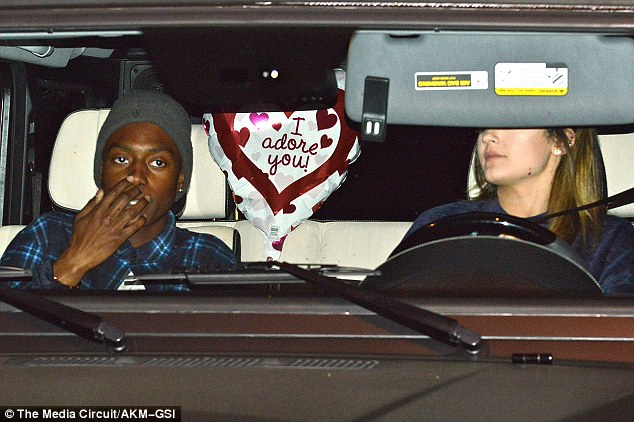 Late Valentine's? In the backseat of Kylie's car was a balloon with a romantic message