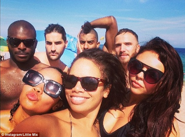 Fun in the sun: Jesy and Leigh-Anne also posted this snap with their manager Sam Coxy and a number of their hunky backing dancers