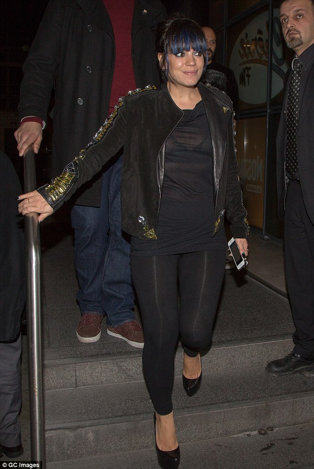 All black: Lily teamed her jacket with a see-through T-shirt as well as some leggings and killer Christian Louboutin heels