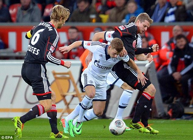 Challenge: Schalke's Max Meyer in action against Leverkusen's Simon Rolfes and Lars Bender