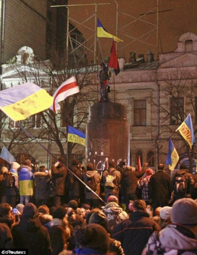 In December anti-government protesters were pictured toppled a statue of the Soviet state founder in Ukraine's capital Kiev