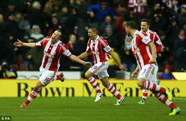 Flying high: Stoke's Adam, left, celebrates scoring the winning goal against Manchester United