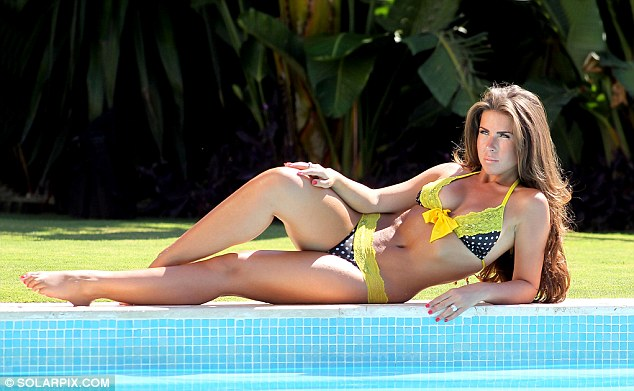 Relaxing by the pool: Sophie-Leigh Adam is a former Miss England