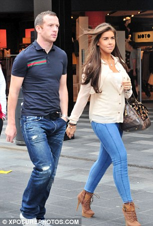 Stepping out: Adam and his wife Sophie-Leigh pictured in 2011