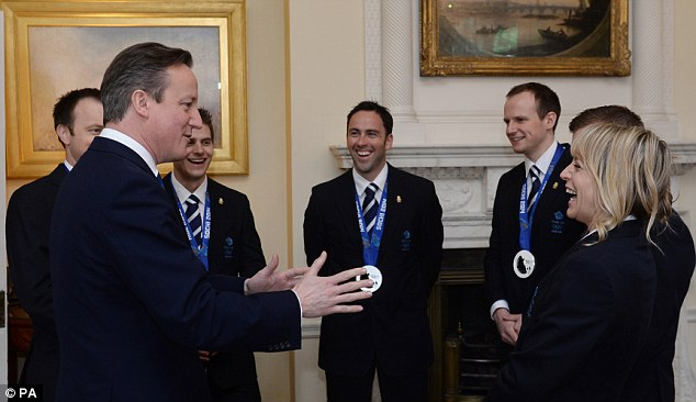 Cameron meets the men's Great Britain Olympic Curling team. In the centre is Dave Murdoch
