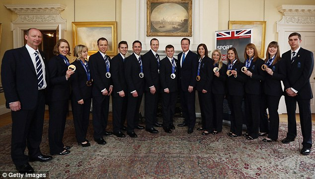 Great Britain's Winter Olympic medalists pose with their medals with David Cameron