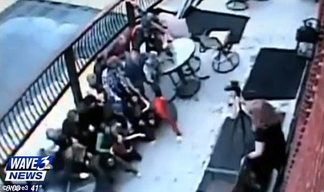 Shock: Family members try to grab on to railings and furniture as the deck gives way