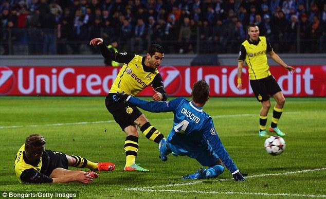 Strike: Henrikh Mkhitaryan hits home past Domenico Criscito to kick off Dortmund's scoring run