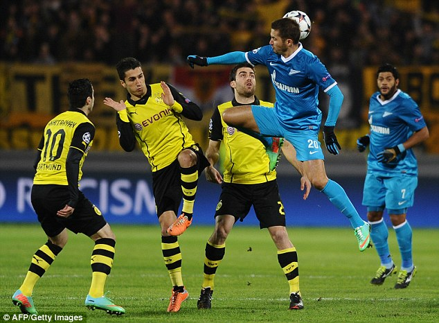 Aerial: Zenit's Viktor Fayzulin flies above Dortmund players including Nuri Sahin (second left)