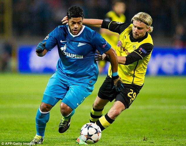 Battle: Zenit's talisman Hulk (left) attempts to outpace Dortmund's Marcel Schmelzer