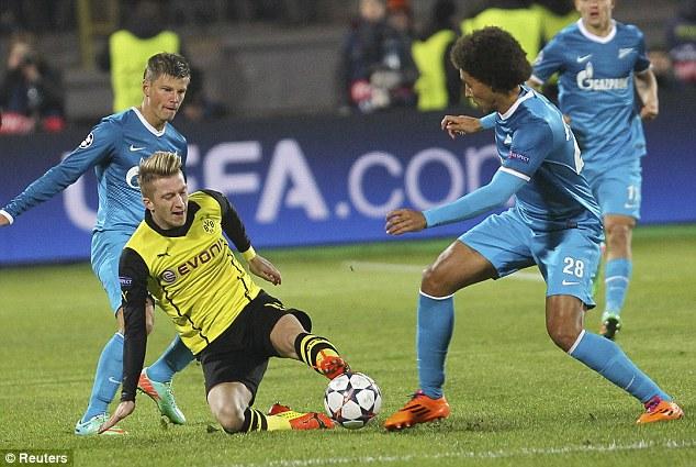 50-50: Dortmund's Marco Reus slides for the ball against Zenit stars Andrey Arshavin (left) and Axel Witsel