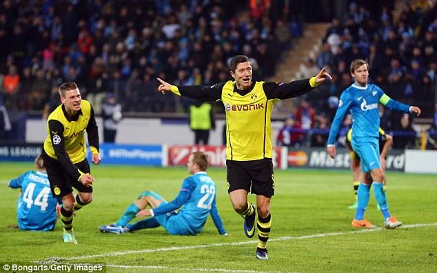 Double trouble: Borussia Dortmund hitman Robert Lewandowski celebrates the first of his two goals