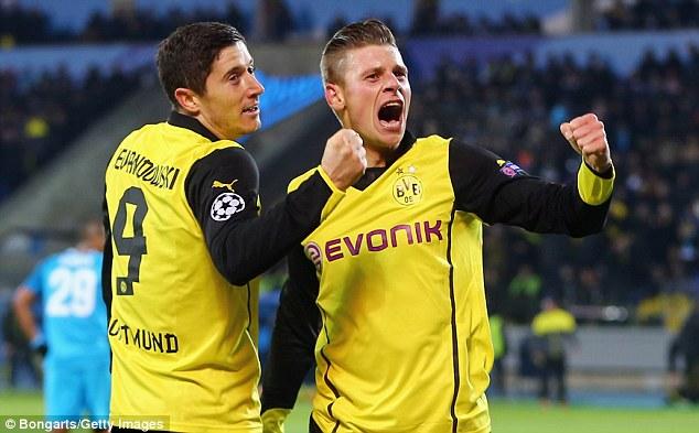 Fist pump: Lewandowski (left) celebrates with Dortmund team-mate Lukas Piszczek