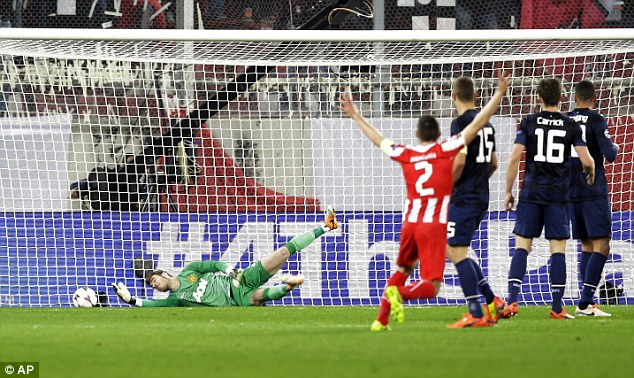 Back of the net: United goalkeeper De Gea (left) can't keep out Alejandro Dominguez's opener for Olympiacos