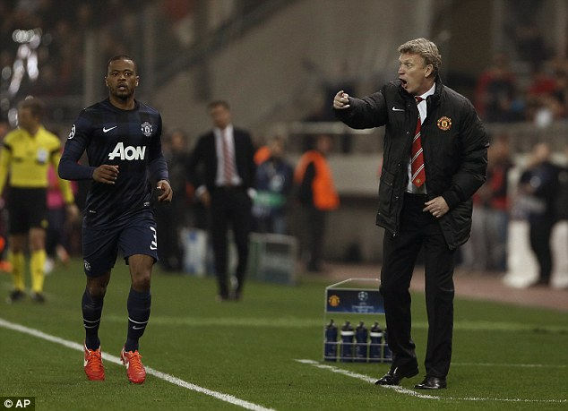 Transition: David Moyes (right) is set to lose Patrice Evra (left) this summer unless the Frenchman can agree a new contract