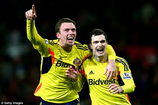 Yellow peril: Sunderland duo Craig Gardner and Adam Johnson celebrate reaching the Capital One Cup final after beating Manchester United on penalties
