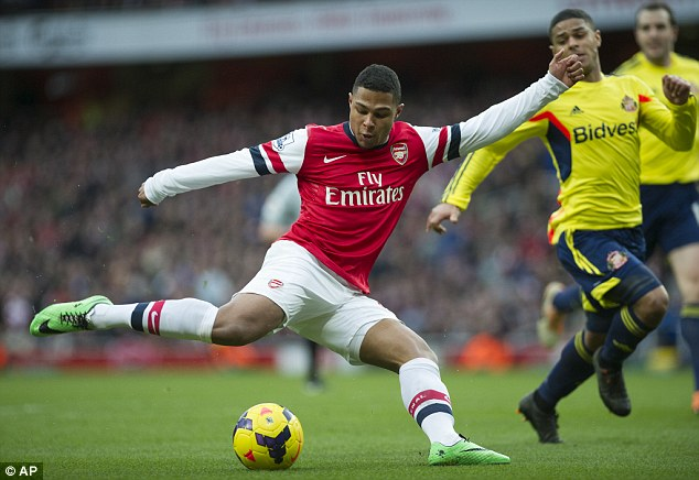 Chasing shadows: Sunderland midfielder Liam Bridcutt, right, seen here being left behind by Arsenal's Serge Gnabry, is unavailable for the City match as he is cup-tied