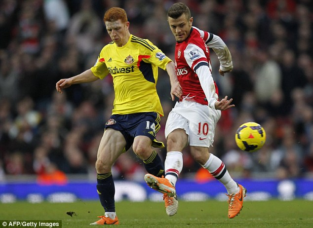 Not ideal preparation: Sunderland midfielder Jack Colback, left, battles for the ball with Jack Wilshere during Arsenal#s 4-1 win on Saturday