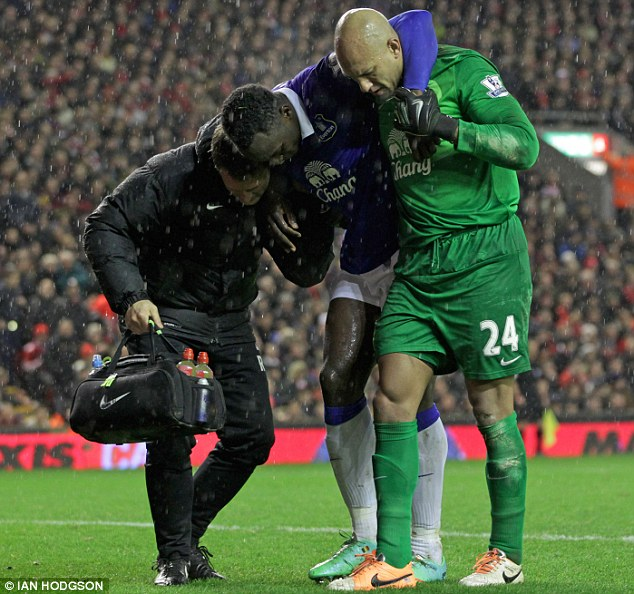 Ouch: Romelu Lukaku picked an injury in the 4-0 loss to Liverpool in January and has not played since but Martinez says the striker is set to return soon