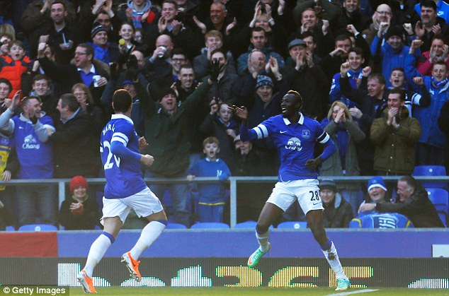 Big miss: Traore, seen here celebrating scoring against Swansea in the FA Cup fifth round, picked up a hamstring injury in the warm-up befoe Saturday's match with Chelsea
