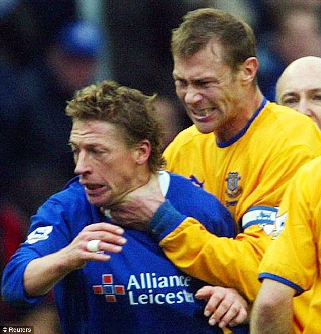 Temper: Ferguson grabs Leicester midfielder Steffen Freund after the German was involved in getting the striker sent off during a match in 2004