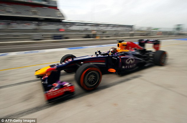 Speeding ahead: Red Bull's German driver Sebastian Vettel races out of a pit stop during a practice session for the United States Grand Prix