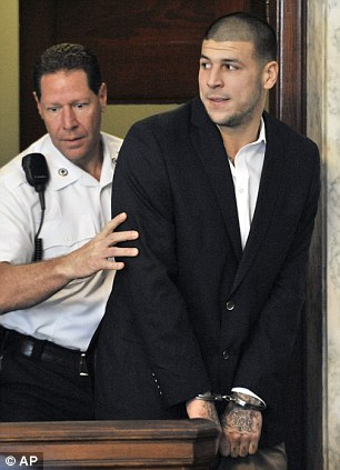 Hernandez is led into court in Attleboro, Mass., last August